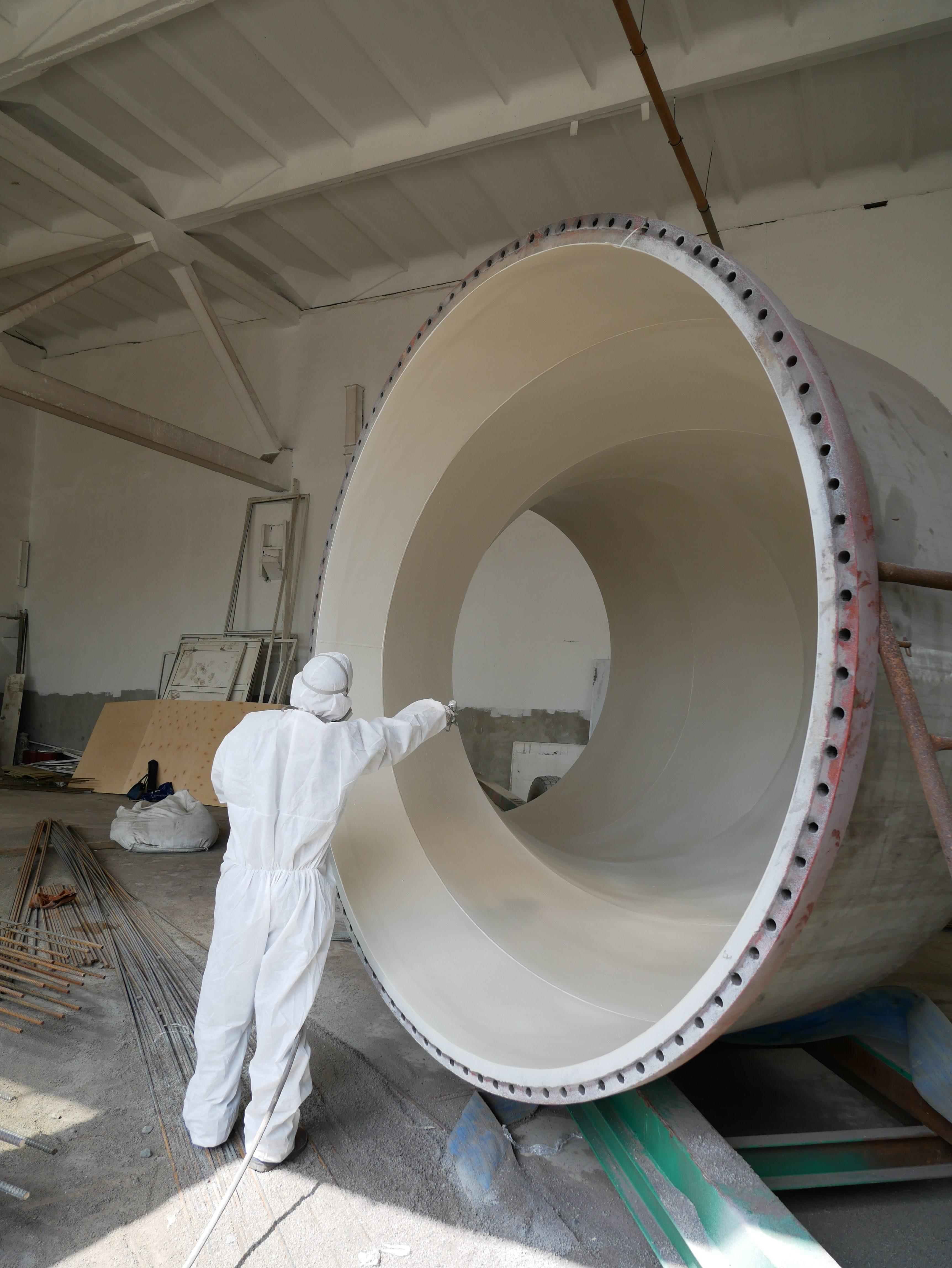 Нанесение покрытия на внутреннюю поверхность отвода